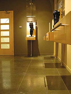 Colormaker Floors coating in Museum Meditation Room in a muted dark gray hue.
