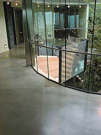 Concrete coating on an interior business center balcony.