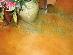 Blue and green speckled floor by ColorMaker Floors created using a concrete overlay and concrete stain.
