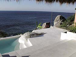 Pure white concrete overlay is a bright addition to a pool deck.