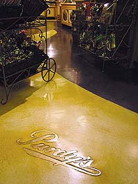 Colormaker Floors - Purdy's logo in a grocery store made of a concrete overlay.