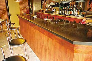 Michael Archambault concrete countertop in a French bar near Paris.