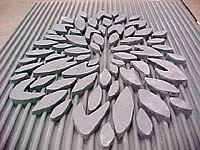 Abstract flower with lined wall in concrete made by using a concrete formliner. Decorative forms by Greenstreak Inc.