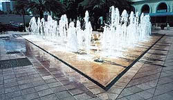 Patio fountains have hidden drains that catch the run off and recycle the water to the pump.