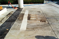 Dirty concrete that needs a good cleaning and not with just a hose.