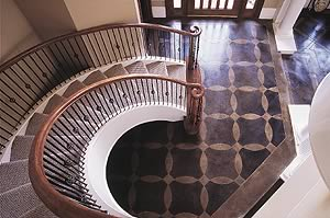 This grand entrance got an acid-stained concrete treatment to give a upscale sophisticated look to the home's entrance.
