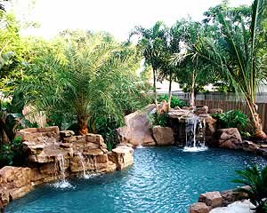 Synthetic rocks take this backyard pool into a beautiful oasis.
