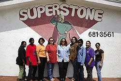 The SuperStone crew poses together in front of the SuperStone logo