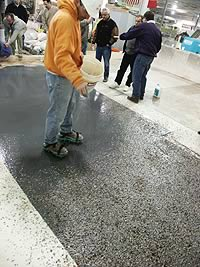 Placing terrazzo is an art, making sure all the pieces are where you want them prior to the material setting.