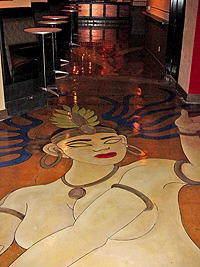 A concrete floor is a perfect canvas of an artistic installation as seen here of a woman created with Super Krete products.