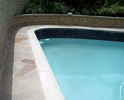 Decorating the edge of the pool is a great way to add life to any old pool surround.
