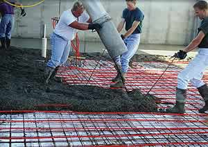 Placing concrete over a radiant heat filled home.
