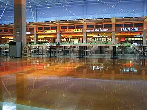 Troweled overlays create a very reflective surface in this airport food court.