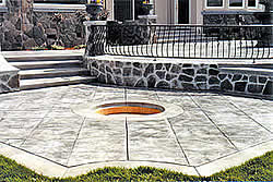 Outdoor patio with stamped and colored concrete done by Julio Hallack of Concrete Innovations