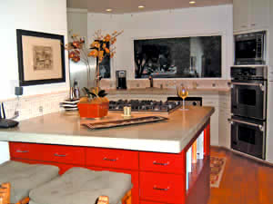 Concrete countertop on a red kitchen island