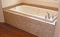 A finalized tub surround that has been created with precast concrete.