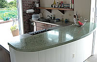 Large bar top kitchen concrete countertop that was precast before installation.