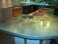 Installing precast concrete countertops puts the finishing look on this kitchen remodel.