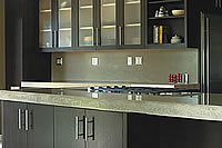 Modern black cabinets with a precast concrete countertop.