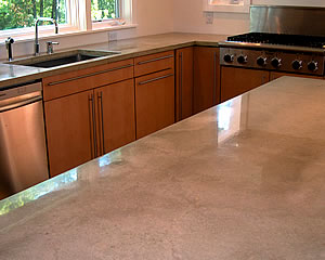 Gray Concrete Countertop That Is Precast And Finished With A Shiny Sealer.