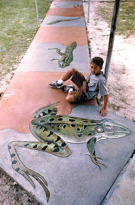 Monarch butterfly and the Southern Leopard frog. Steven Ochs, art professor at Southern Arkansas University, conducted the research and drew the designs, while Gerald Taylor of Images in Concrete used an angle grinder with a diamond blade to engrave the lines. Coloring was done with acrylic and acid stains, and several layers of gritted sealant were used to ensure many years of beauty and protection.
