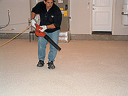 "Versatile Liquid Granite Chip Flooring System - The accelerators worked. After the first coat of Versathane started curing, it had ""the same integrity as if someone had done it without an accelerator in 70°F or 80°F heat,"" Glendrange said. ""The edge of the garage was tacky, but you could walk on it."""