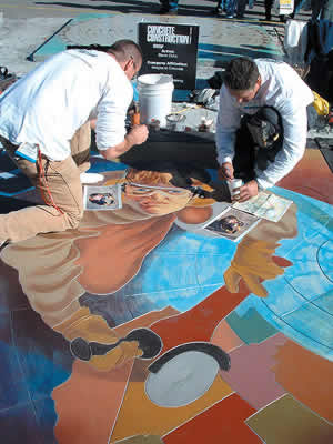 Coloring concrete using colored acrylic water based concrete stains into an image of a concrete contractor using a red and black grinder at the World of Concrete 2005