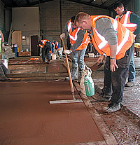 Lafarge UK Spring Training troweling the edge of colored concrete.