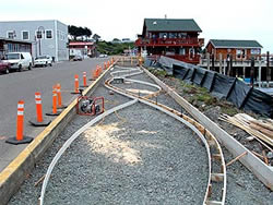 Bandon Boardwalk Construction - The two sides of the walkway were also doweled together, to keep one half from settling below the other over time. After both sides were finished, the entire concrete surface was coated with an acrylic sealer.