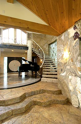 Bomanite interior concrete floors and walls in a beautiful House with a grand Piano