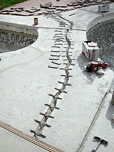 Concrete is known to crack but there are ways to avoid the crack to show through a new overlay.