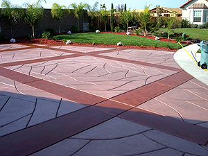 Integrally colored concrete using a broomed finish and a bull float or fresno trowel.