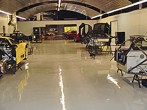 Seamless Floor Coatings in an large industrial warehouse where heavy machines are moved across the floor.