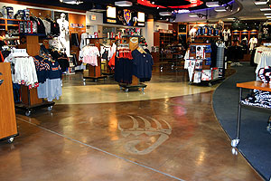Chicago Bears' Team Store has a light etched paw print in the stained concrete floor.