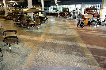 An award-winning stamped concrete floor in The Great Escape, a store in Joliet, Ill. where three different stamp designs were used to make way finding easier.