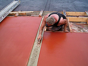 Pattern-Crete Warehouse and Shop - Tucker poured and finished the concrete, and while it was still wet he broadcast a color hardener. He used Brick Red from Butterfield Color as the field color and accented it with Deep Charcoal.