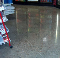 Polishing Concrete - RetroPlate with exposed aggregate in a retail setting.