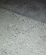 Polishing Concrete - has there been weather damage or excess water on this concrete slab?