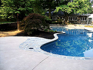 "Pool Decks Photo courtesy of Architectural Concrete Design. ""The American Concrete Institute (ACI) says a gravel base is not necessary. You just need a stable base. In Georgia they pour on clay. In the North we use gravel as a thermal stabilizer — it is an insulator on expansive soil. You can pour right on stable sand too."