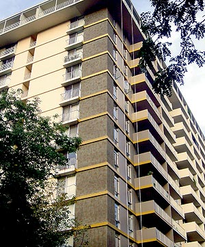 "Vertical Stenciling of Concrete - Contractor Rod Scott used stencil tape and an overlay to create the look of slate on this high-rise. This ""brick"" surface was created with custom-cut vinyl stencils and an overlay."