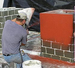 """The stucco-style plastering technique is the most common way to apply stencils to a vertical surface, Monroe says. The other common method is to use stencils and colorants when creating decorative flatwork for tilt-up construction. Photos courtesy of Decorative Concrete Impressions Applying and troweling a stenciled overlay."