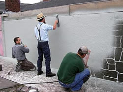 "Applying and troweling a stenciled overlay. - Concrete stencil supplier Artcrete Inc. offers both the spray-on and tilt-up approaches to vertical concrete applications. ""The use of stenciling on vertical surfaces is just now becoming more popular,"" says Artcrete national director of training Steve Peters."