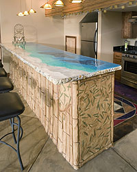 JAF-Co Concrete built this cabana style concrete countertop with layers of the ocean theme from a sandy beach to the deep blue sea