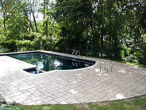A pool deck that has had a stamped concrete makeover.