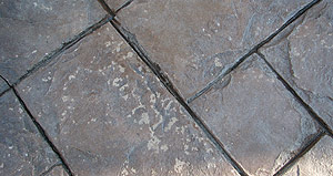 Problems with concrete sealers - Examples of sealer delamination, possibly due to the use of salt or de-icing chemicals.