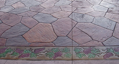This grapevine design shows how Bob Harris uses water-based acrylic stain to accent acid-stained stamped vertical concrete.