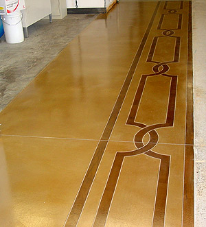 Overlays on Concrete Floors - Native American design flows down a hall way that has a microtopping overlay treatment.