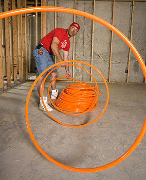 Radiant tubing is prepared for a home in Idaho Falls, Mo.