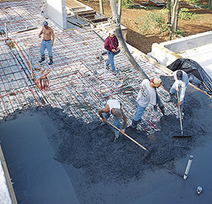 A bird's-eye view of a concrete pour with radiant heat equipment.