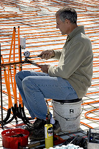 "Bob ""Hot Rod"" Rohr installs radiant heat equipment on an under-concrete job in Branson, Mo."